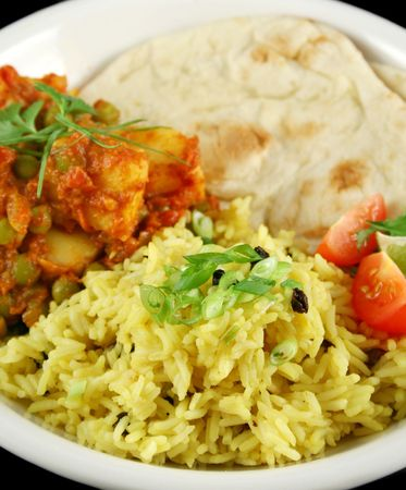 tumeric: Indian pea and potato curry with tumeric rice and a side salad.