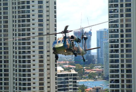 indy: Australian Army Blackhawk flies between skyscrapers at the Indy 300, Surfers Paradise, Australia.