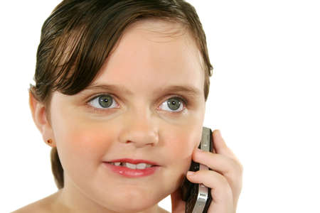 look after: Little girl with a happy look after listening to her cell phone.