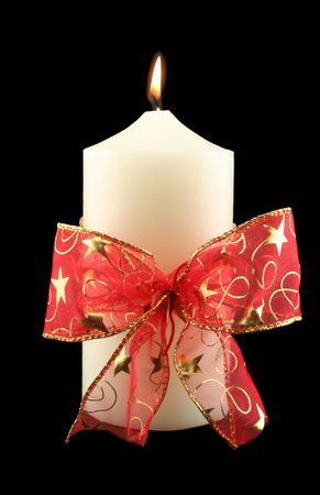 meaningful: Christmas church candle with red decorative bow. Stock Photo