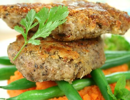 Crumbed lamb cutlets on green beans and sweet potato mash with coriander. Stock Photo - 3876493