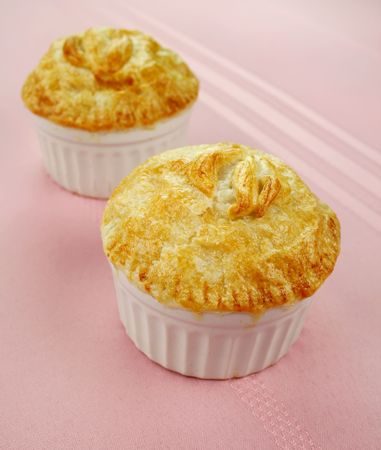 homestyle: Fresh baked golden homestyle chicken pies. Stock Photo