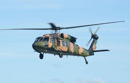 manoeuvre: Australian Army Blackhawk chopper flies by. Stock Photo