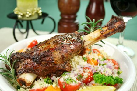 shank: Roasted lamb shank on tomato, butternut pumpkin and parsley couscous Stock Photo