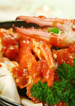 Delicious fresh cracked sand crab in a spicy tomato sauce with parsley. photo