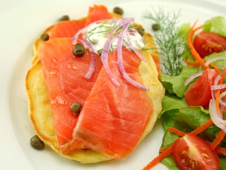 fritters: Corn fritters topped with smoked trout with dill, capers and cottage cheese. Stock Photo