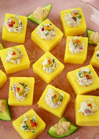 Polenta: Tuna filled polenta squares with cream cheese, olives and parsley.