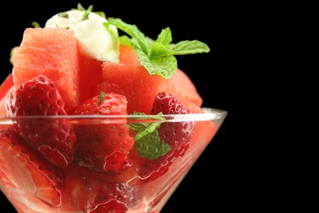 Strawberry and watermelon pieces in a glass with copy space.