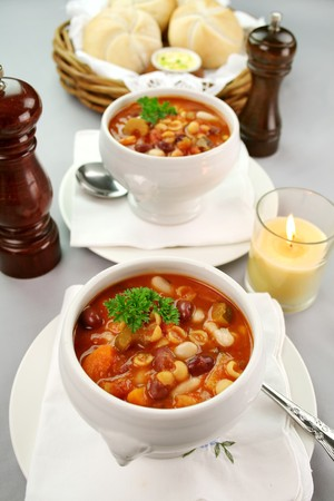 Delicious minestrone soup with fresh baked bread rolls and butter. photo