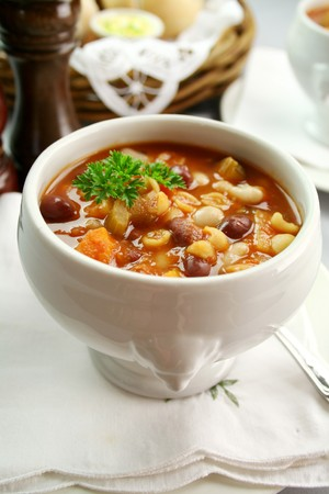 Delicious minestrone soup with fresh baked bread rolls and butter. Stock Photo