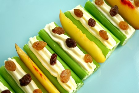raisin: Healthy afternoon snack of celery sticks with cream cheese and sultanas.