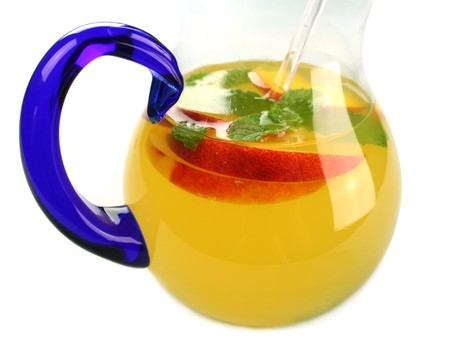 Delicious icy cold peach and mint punch ready to serve. photo