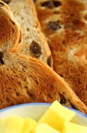sultana: Delicious slices of toasted sultana bread with butter cubes.