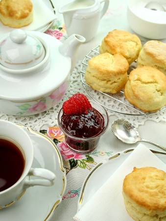 Devonshire tea and fresh baked scones with jam and cream. photo