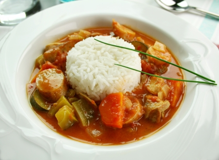 Delicious chicken gumbo with rice, sausage, peppers, onions, carrots and tomatoes.