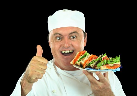 badly: Chef in training gives the thumbs up to a badly made trashed salad sandwich. Stock Photo