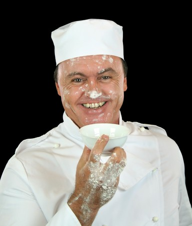 bedraggled: Smiling chef has had a nasty accident with the flour.
