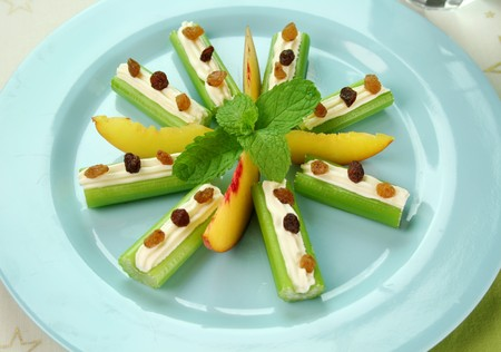 sultanas: Healthy afternoon snack of celery sticks with cream cheese and sultanas.