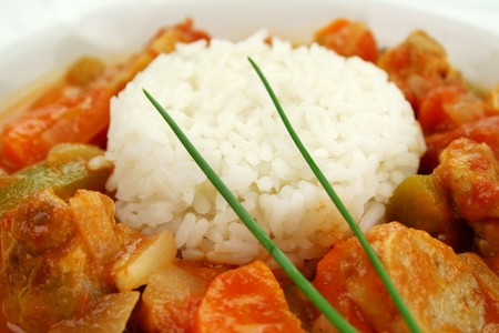 Delicious chicken gumbo with rice, sausage, peppers, onions, carrots and tomatoes. Stock Photo - 4547242