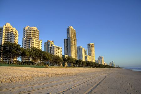 chillout: Surfers Paradise beach, Gold Coast Australia in the early morning golden light.