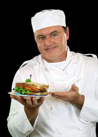 Chef presents healthy salad sandwich ready for serving.