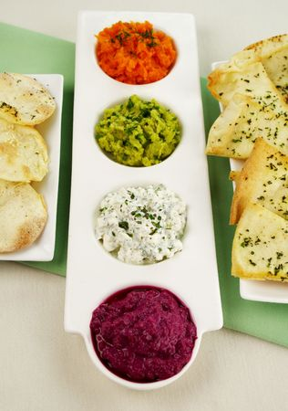 flavorful: Assorted dips of beetroot, carrot, cottage cheese and herbs, pea and basil with pita crisps.