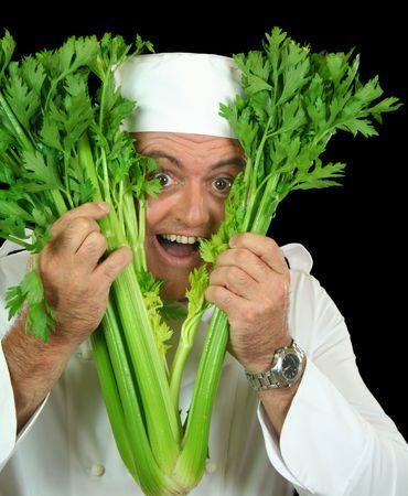 peekaboo: Peekaboo chef pops his head through a bunch of fresh celery.