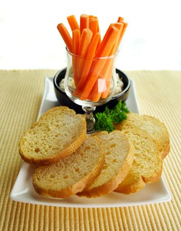 julienne: Crisp toasts with pineapple ricotta spread with julienne carrots. Stock Photo