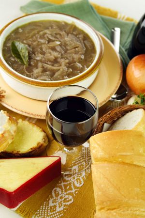 Red wine with french onion soup with cheese and bread ready to serve. photo