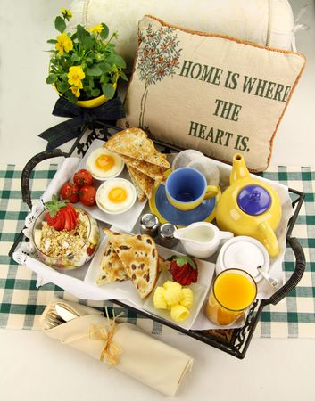 Delicious hearty breakfast tray prepared for a lazy Sunday morning.