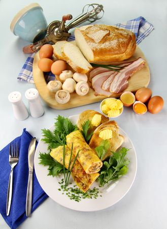 freshly prepared: Delicious rolled mushroom and bacon omelette freshly prepared and ready to serve. Stock Photo