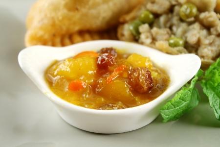 samosa: Indian vegetarian samosa with mango chutney.
