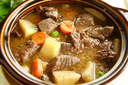 Rich hearty beef stew simmering and ready to serve. Stock Photo