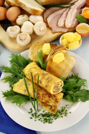 Delicious rolled mushroom and bacon omelette freshly prepared and ready to serve. photo