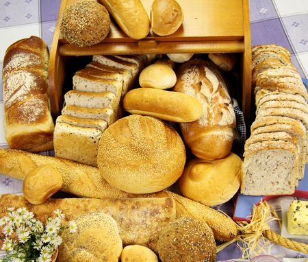 Selection of different types of rolls, loaves and bread sticks. photo