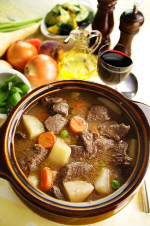 Freshly baked beef stew with olive oil and fresh vegetables. Stock Photo