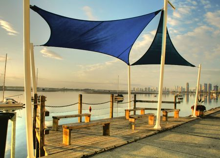 Shade sails over benches by the Broadwater on the Gold Coast Australia. Stock Photo