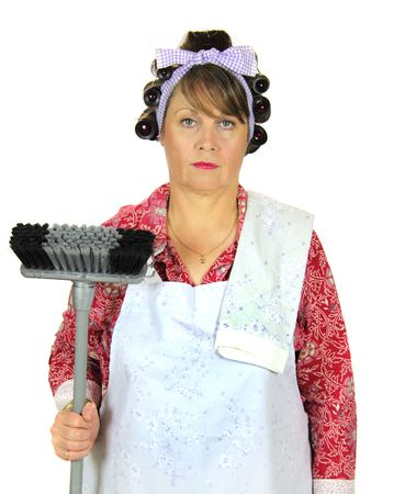 apathetic: Unhappy and apathetic frumpy housewife standing with broom.
