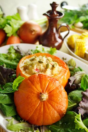 Baked golden nugget pumpkin with rice stuffing ready to serve. photo