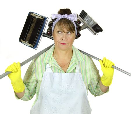 apathetic: Bored frumpy housewife with carpet sweeper and broom over her shoulders. Stock Photo
