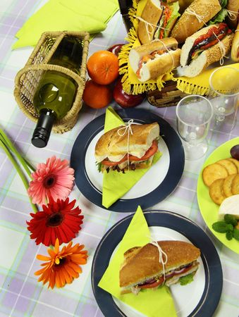 Picnic rolls served with white wine and cheese and crackers. photo