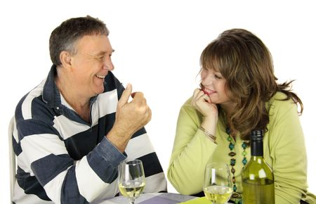 confab: Middle aged couple having a conversation over lunch.