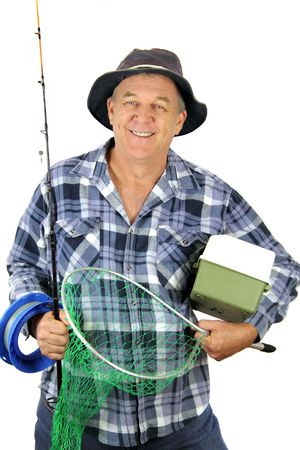 tackle: Middle aged fisherman carrying all the gear for a days fishing.