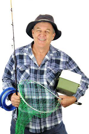 pescador: Pescador de mediana edad llevar todo el equipo para un d�a de pesca. Foto de archivo