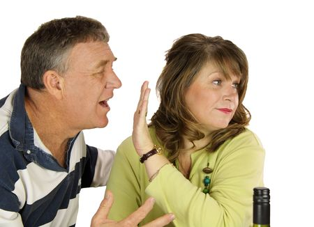 confab: Unhappy middle aged couple arguing over lunch. Stock Photo