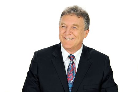 looking away from camera: Smiling middle aged businessman looking away from camera.