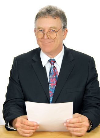 geeky: Geeky business executive smiles looking over his old fashioned glasses. Stock Photo