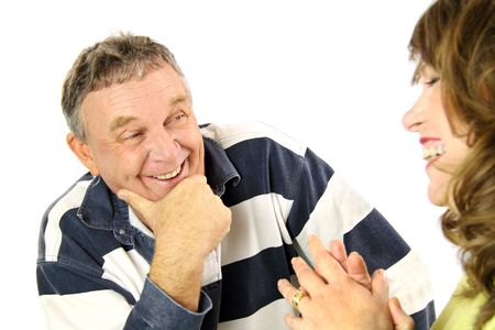 confab: Happy middle aged couple chatting and enjoying quality time together. Stock Photo