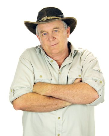 Casual middle aged man standing with arms crossed with a hat. Stock Photo - 5351791