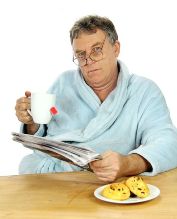 Grumpy middle aged man trying to wake up early at breakfast time. Stock Photo - 5351793